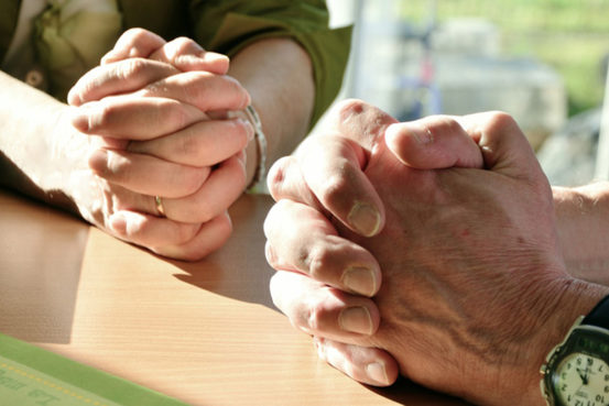 2 pairs of hands praying