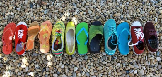 Colored shoes lined up in a row.